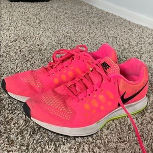 Nike running shoes in bright pink